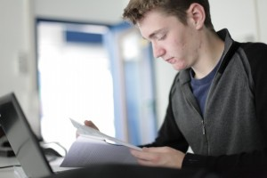 Student_Boy_Reading_Papers